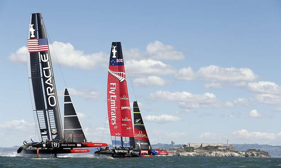 Emirates Team New Zealand (right) pulls ahead of Oracle Team USA on the first windward leg of Race 19 of the America's Cup Finals on Wednesday, September 25, 2013 in San Francisco, Calif. Photo: Beck Diefenbach, Special To The Chronicle