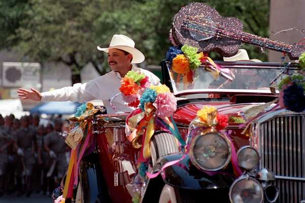 Grand Marshal Emilio Navaira acknowledges the crowd at the Battle of Flowers parade on April 24, 1998.