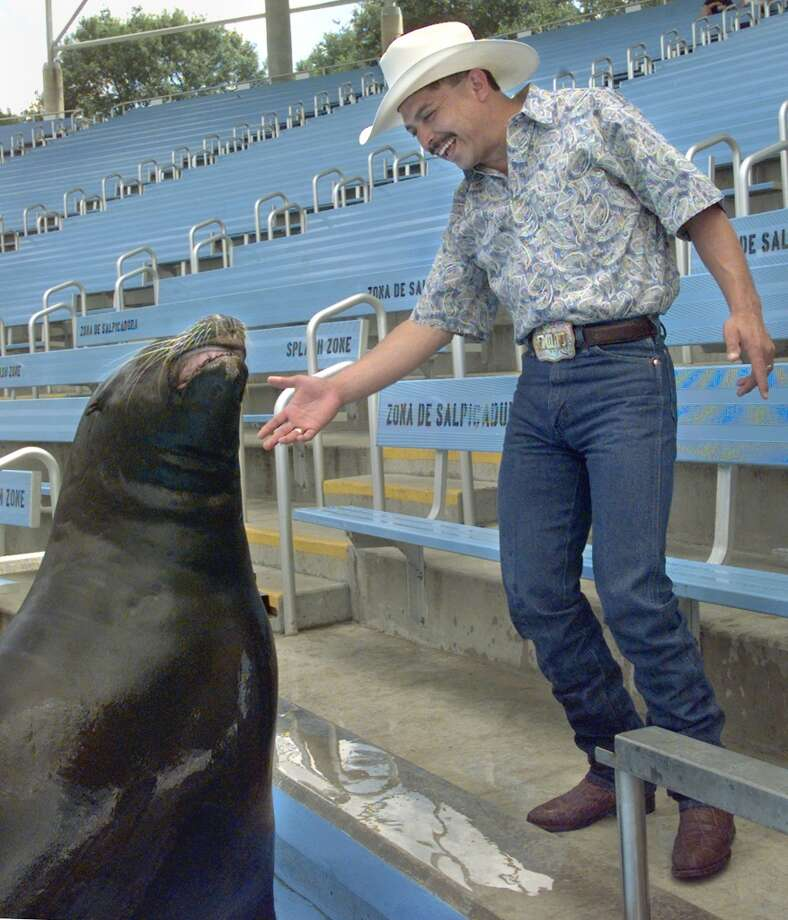 Tejano star Emilio Navaira tries to dance with Clyde the sea lion at Sea World during his visit there to promote the American Lung Association's July 10 attempt at the world record for people in a line dance in 1999. Photo: Tom Reel, SAN ANTONIO EXPRESS-NEWS