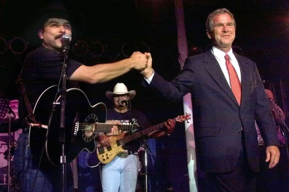 Emilio Navaira congratulates George W. Bush on his win in the Iowa straw poll Saturday in Ames on August 14 Photo: Tom Reel, SAN ANTONIO EXPRESS-NEWS