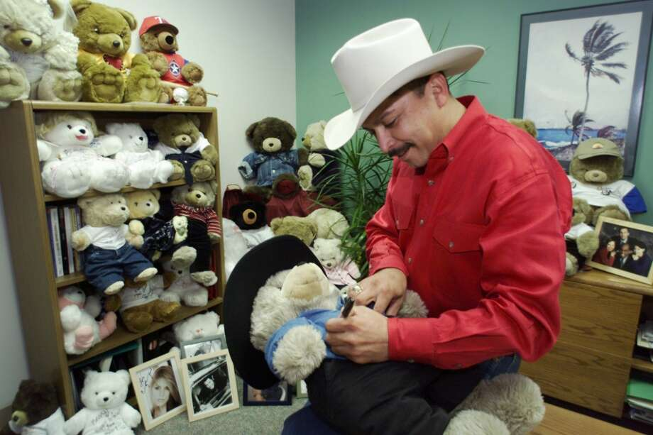 Tejano singer Emilio Navaira signs his teddy bear at Rivercenter Mall on Monday, Nov. 15, 1999. The teddy bear is part of several signed bears that will be auction starting on Nov. 19 with proceeds benefiting Family Services Association. Photo: JERRY LARA