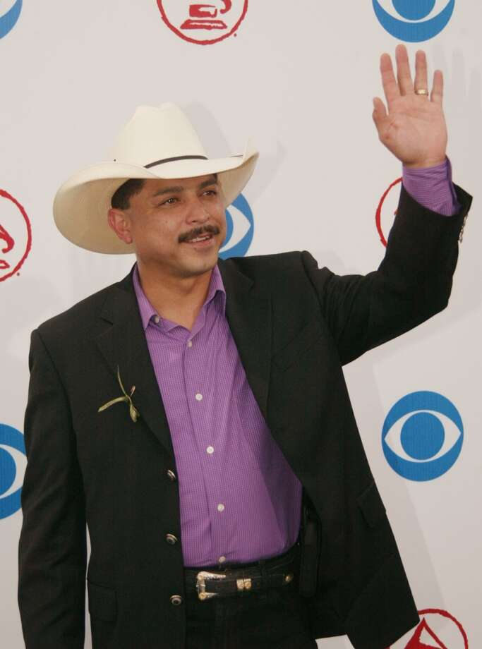 Latin Grammy nominee Emilio Navaira waves to the crowds upon arrival at the 4th Annual Latin Grammy Awards in Miami, Wednesday Sept. 3, 2003. Navaira is nominated for best Tejano album. Photo: WILFREDO LEE, AP