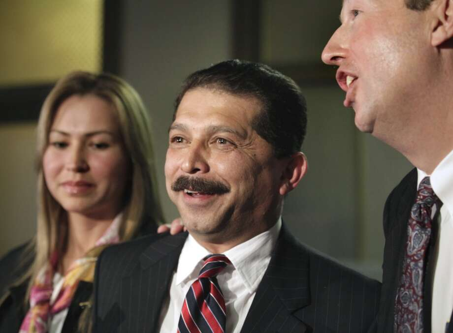 Emilio Navaira, center, speaks to the media following his trial at the Bexar County Courthouse, Monday, Jan. 10, 2011. With him are his wife Maria Eugenia Navaira, left, and his lawyer Larry Goldman. Photo: BOB OWEN, SAN ANTONIO EXPRESS-NEWS