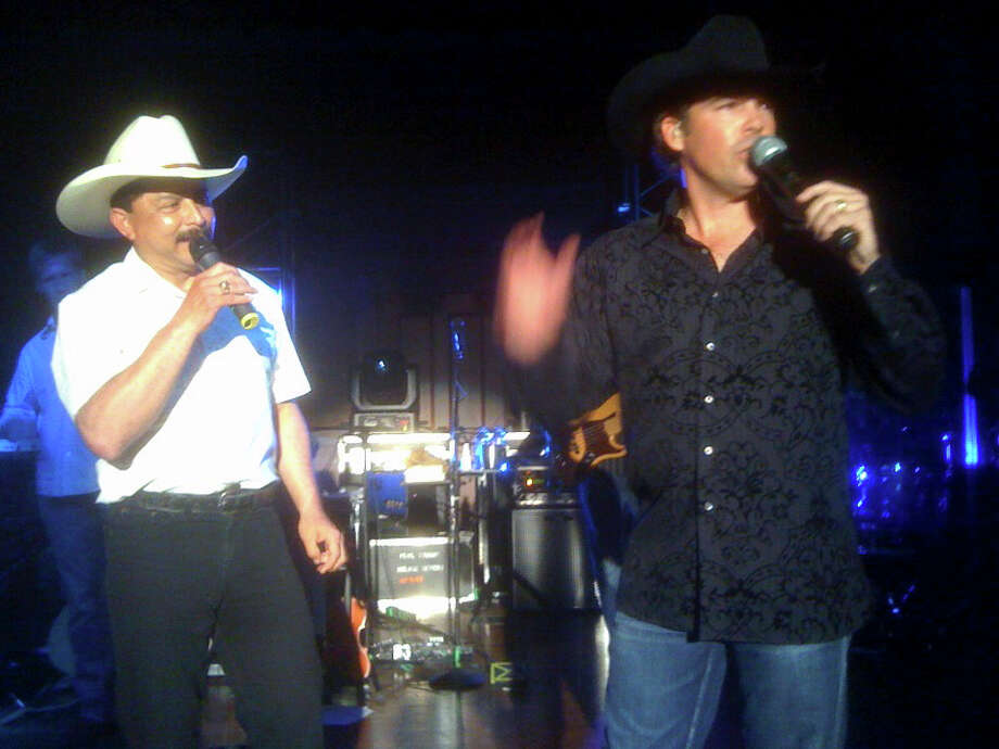 Grammy-winning Tejano singer Emilio Navaira, left, performs Saturday night April 10, 2010, during a fundraiser at the Pearl Stable with singer Clay Walker. It was Emilio's first public performance since the singer's bus crashed in March 2008 while Emilio drove the vehicle in Houston. Photo: RICHARD MARINI, SAN ANTONIO EXPRESS-NEWS / © 2010 San Antonio Express-News