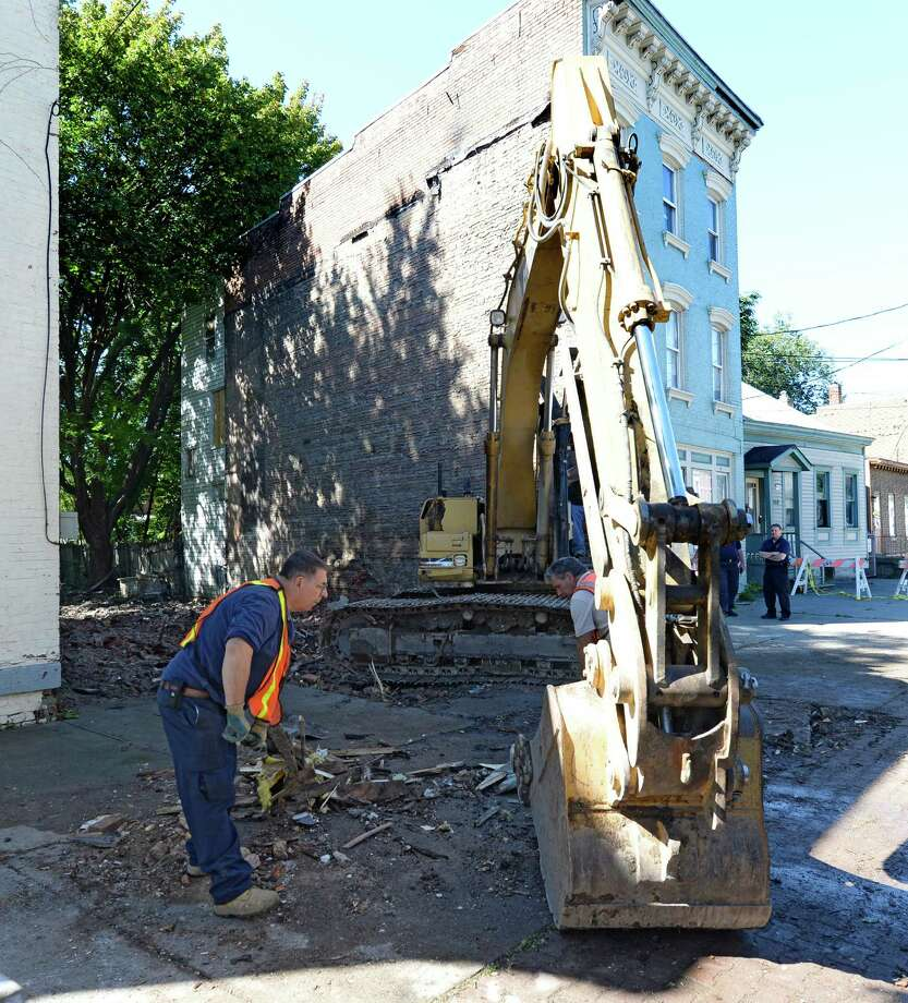 The last remains of 576 Clinton Avenue are removed Wednesday afternoon, Sept. 25, 2013, in Albany, N.Y.The building was demolished Tuesday night (Skip Dickstein / Times Union) Photo: Skip Dickstein
