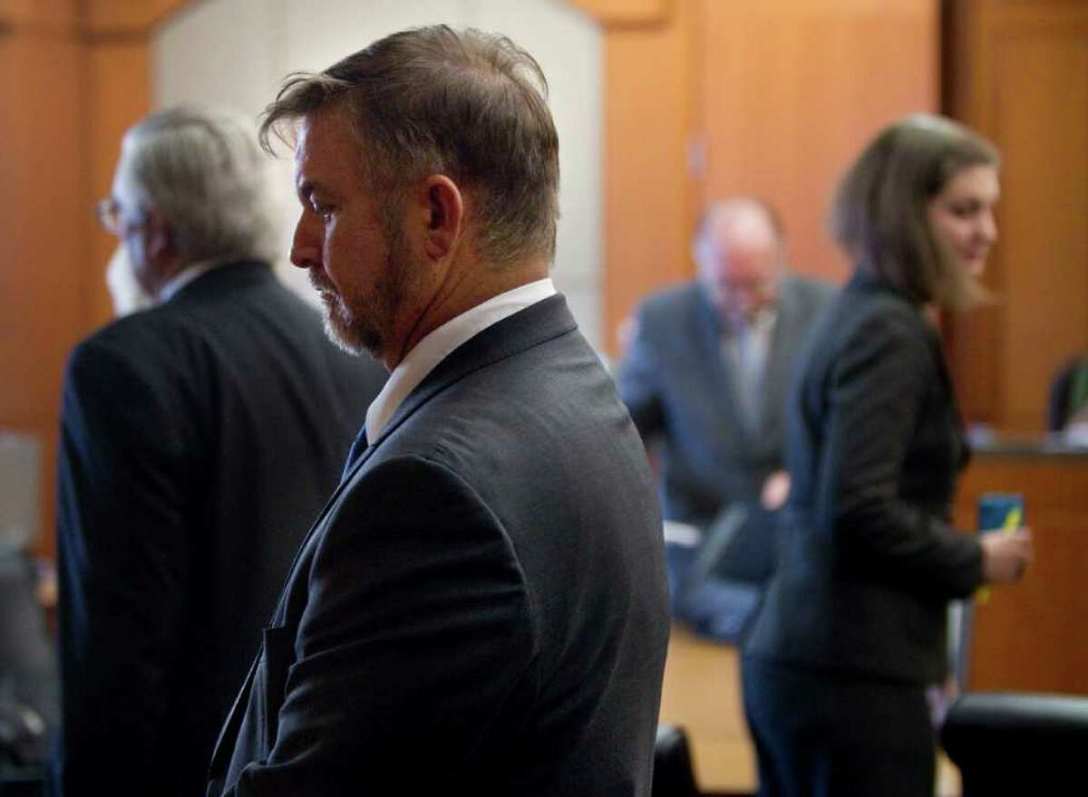 Michael Brown stands in the courtroom during a hearing Friday, Oct. 21, 2011, in Houston. Less than a month after being acquitted for domestic violence, the former hand surgeon fought a protective order that was agreed to in 2010. Brown was prohibited from communicating with his wife or their three children, according to the 2010 order. Arguments to lift the order were reset for a later date.