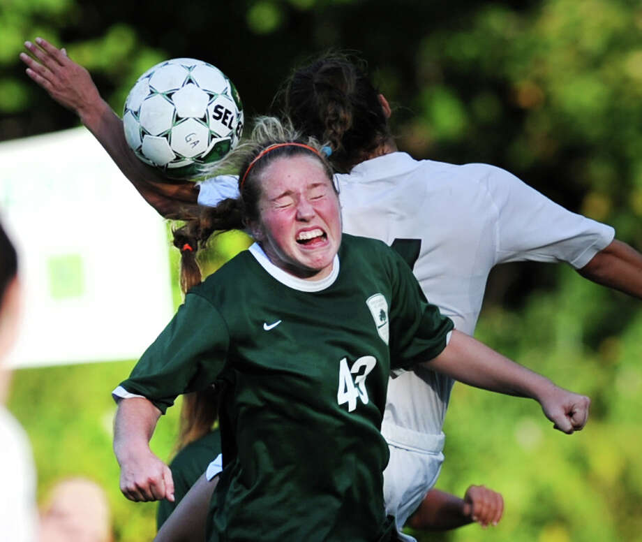 Greenwich Academy's Katherine Tenefrancia (# 43) heads the ball during the girls high school soccer match between Greenwich Academy and Convent of the Sacred Heart at Greenwich Academy, Sept. 25, 2013. Tenefrancia scored the first goal of the game for Greenwich Academy. Photo: Bob Luckey / Greenwich Time