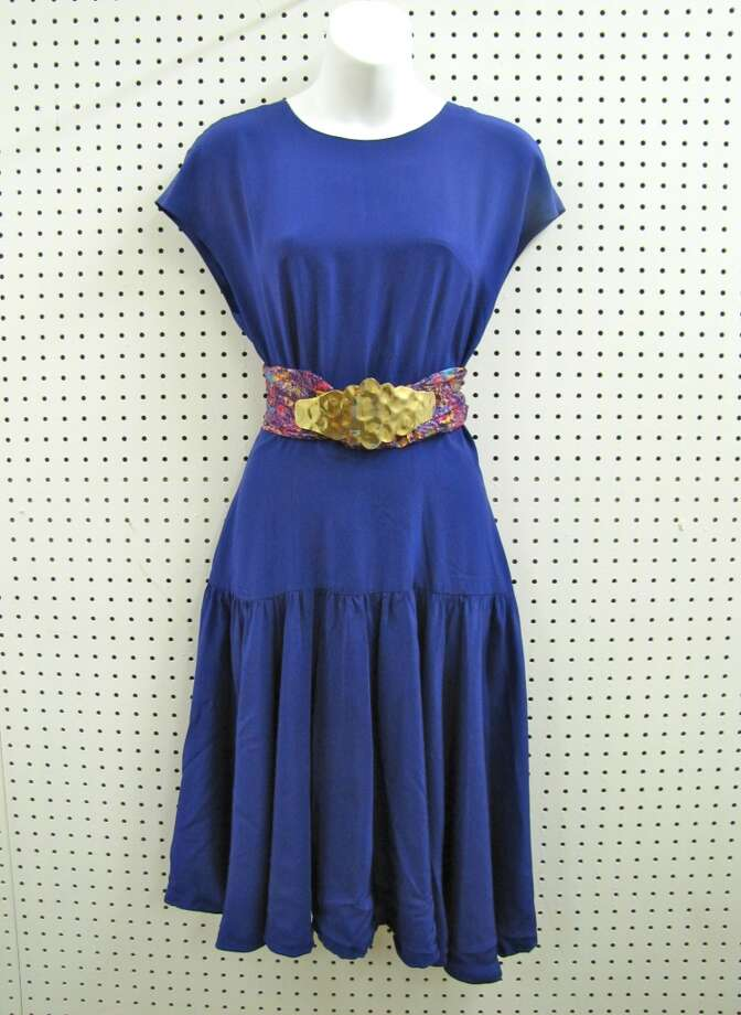 Purple drop waist dress, $29.99. Upcycled belt, $4.99.  Vintage belt buckle, $15.50. NV Boutique, Beaumont Photo: Cat5