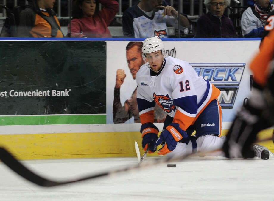 Sound Tiger defenseman Calvin De Haan looks to pass the puck from his knees during their matchup with the Adirondack Phantoms at the Webster Bank Arena in Bridgeport on Sunday, October 16, 2011. Photo: Brian A. Pounds / Connecticut Post