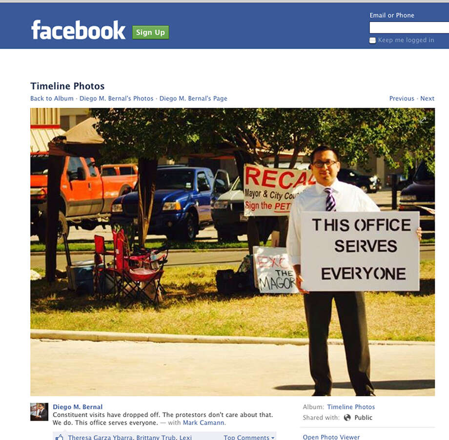 San Antonio City Councilman Diego Bernal stands outside his office to counter protesters who he says are detering constituents' visits to his office.