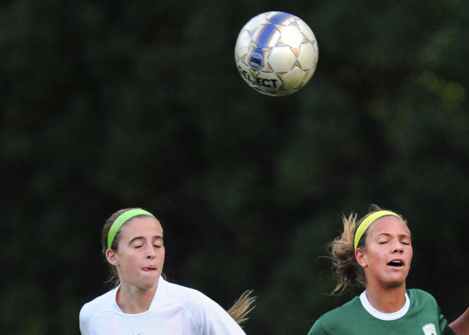 At left, Convent's Delaney Colaio (# 14) of Convent and Emma Nossier (# 13) of Greenwich Academy during the girls high school soccer match between Greenwich Academy and Convent of the Sacred Heart at Greenwich Academy, Sept. 25, 2013. Photo: Bob Luckey / Greenwich Time