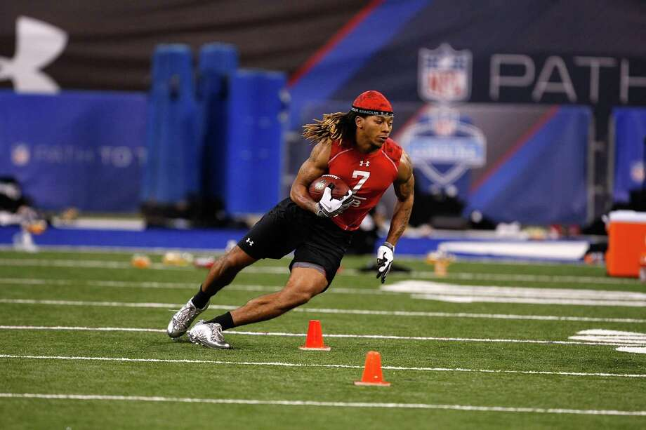 INDIANAPOLIS, IN - FEBRUARY 28: Running back Andre Dixon of Connecticut runs during the NFL Scouting Combine presented by Under Armour at Lucas Oil Stadium on February 28, 2010 in Indianapolis, Indiana. (Photo by Scott Boehm/Getty Images) Photo: Scott Boehm, ST / 2010 Getty Images