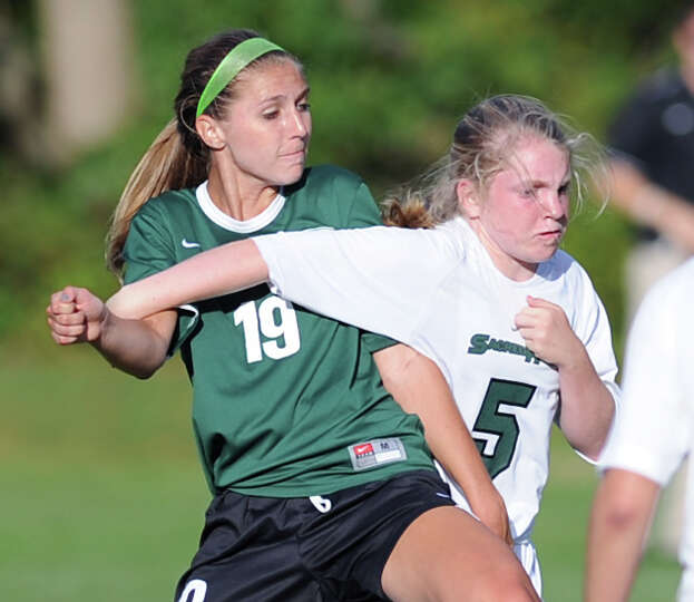 Greenwich Academy's Ellie Dempsey (# 19), left, and Emily Cleary (# 5) of Convent, mix it up during