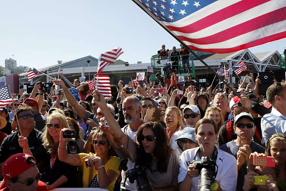 Waterfront crowds cheer on Oracle Team USA before the trophy ceremony to conclude the 34th America's Cup. Photo: Michael Short, Chronicle Photo