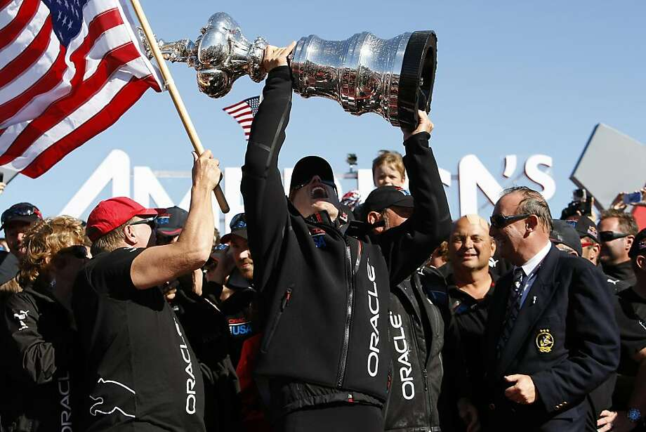 Oracle Team USA skipper Jimmy Spithill hoists the America's Cup during the America's Cup Awards Ceremony in San Francisco, CA Wednesday September 25, 2013. Photo: Michael Short, The Chronicle