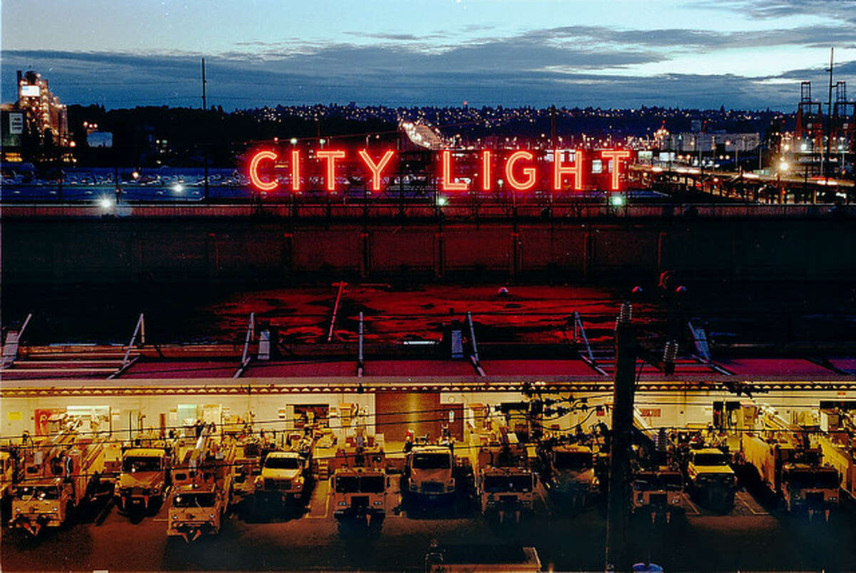 A Seattle City Light sign atop a South Seattle service center, visitble from the West Seattle Freeway.