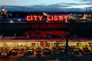 A great example of government neon. (Seattle City Light sign atop a South Seattle service center, visitble from the West Seattle Freeway, pictured in 1998).