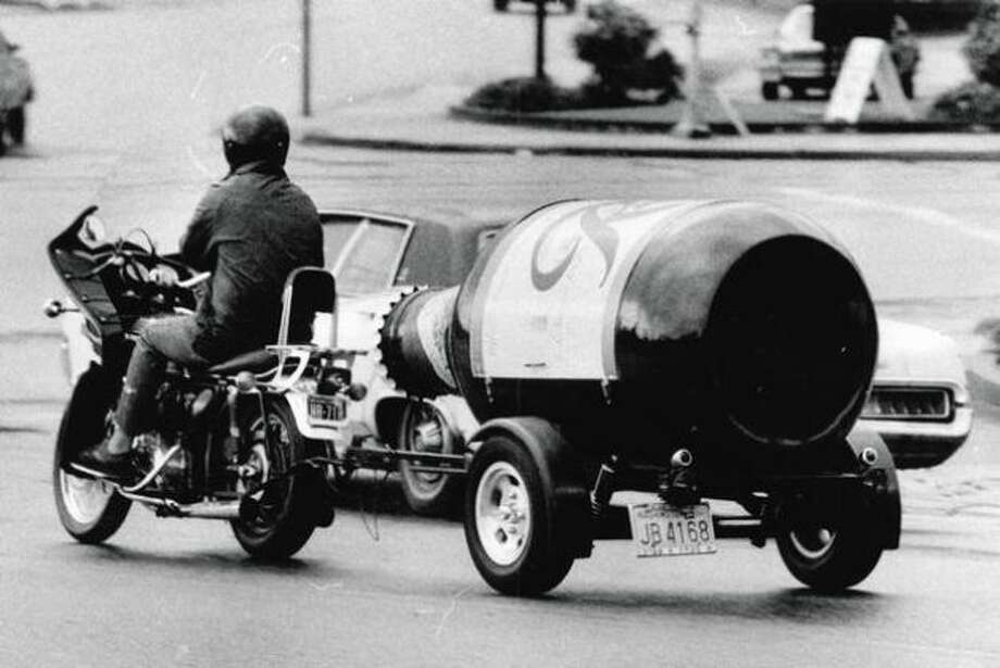 Just a motorcycle pulling a giant bottle of Rainier in 1974. Photo: P-I File