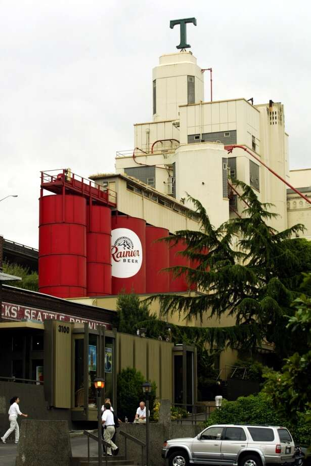 "Tully's ""T"" stands on the old Rainier brewery, now called the Rainier Commons. Bought from bankruptcy in 2013, Tully's is moving out of the building, which prompted building owner, Shimon Mizrahi, to want the Rainier ""R"" back.  