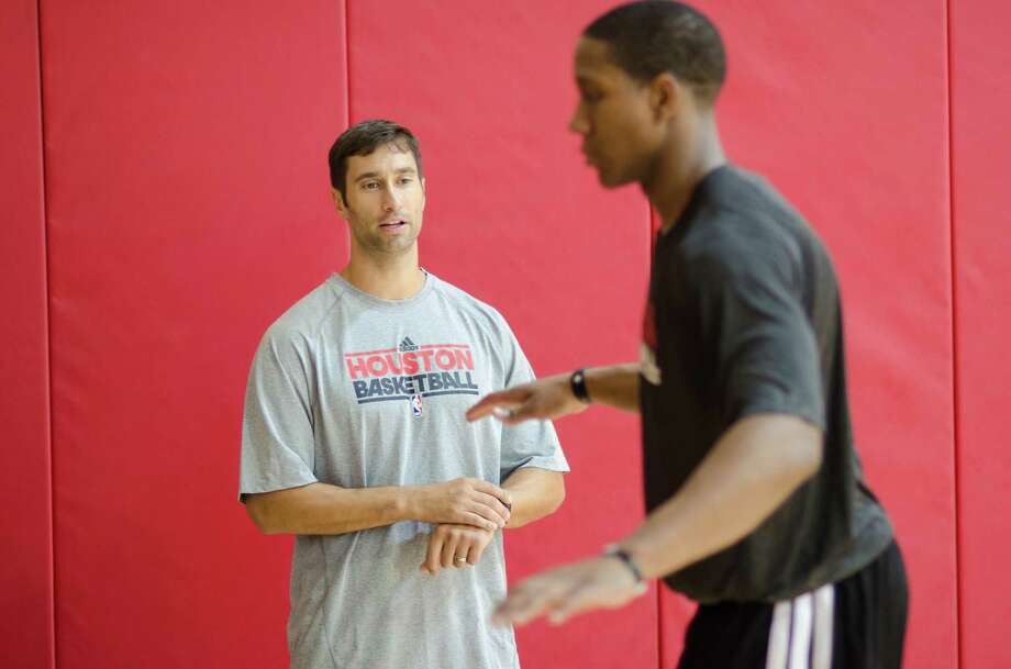 "As rookie Isaiah Canaan is finding out, Joe Rogowski, left, is bringing ""a different culture in strength and conditioning"" to the Rockets. Photo: Jamaal Ellis / ©2013 Houston Chronicle"