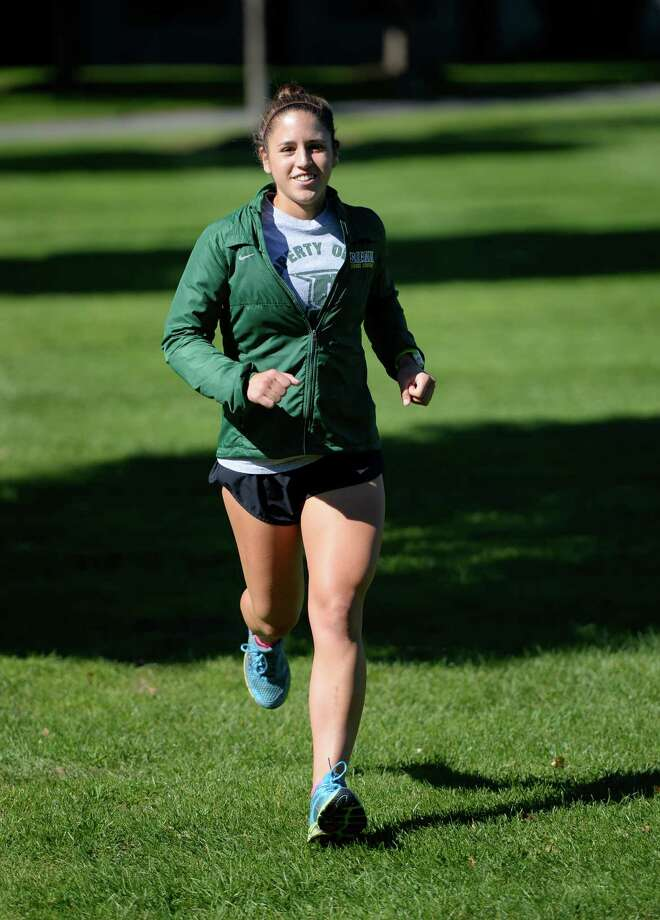Siena cross country star Christie Macfarlane worksout during a training run Tuesday morning, Sept. 24, 2013, on the Siena campus in Loudonville, N.Y.      (Skip Dickstein / Times Union) Photo: Skip Dickstein
