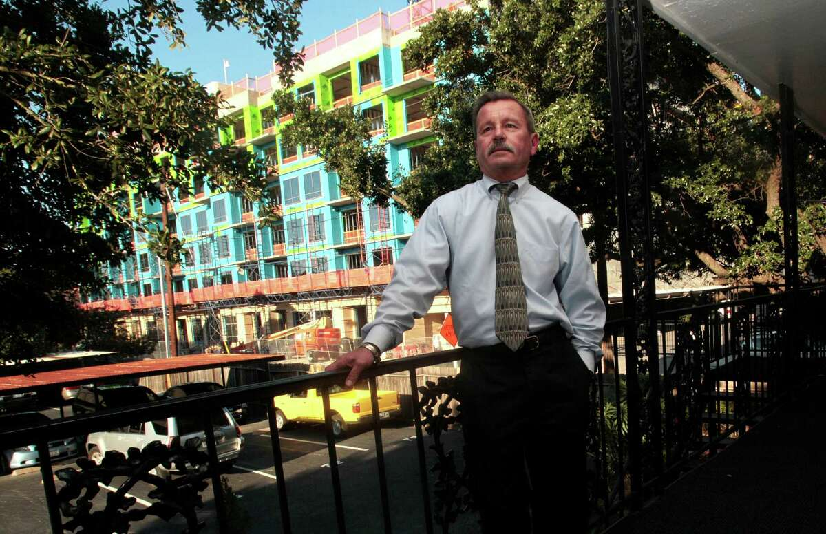 Rick Forest rents at Allen House Apartments in a hot inner Loop area. The complex is being replaced by an upscale urban village.