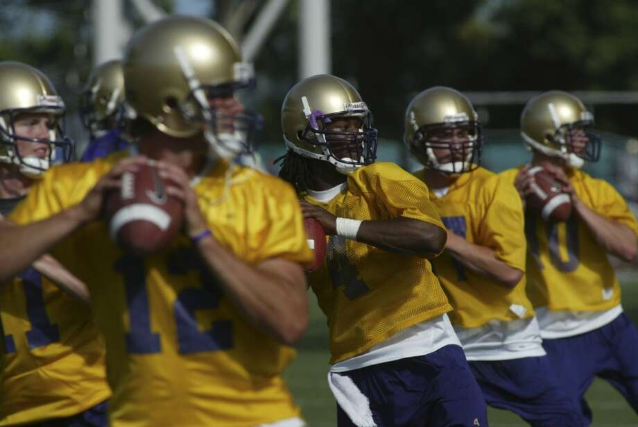 A blue-chip recruit, Locker (right) was the star of Washington head coach Tyrone Willingham's 2006 signing class, but he couldn't beat out the four other quarterbacks on the UW roster and worked exclusively on the scout team during his true freshman season. Photo: Grant M. Haller