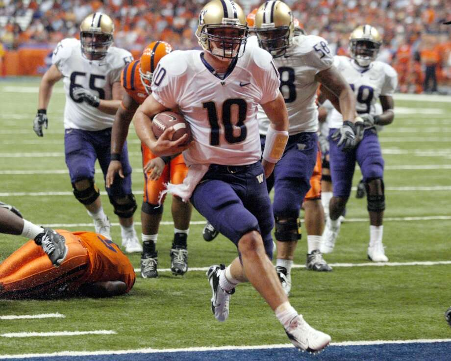 Locker made quite a splash in his first start as a Husky, rushing for two touchdowns in the 2007 season-opening 42-12 win at Syracuse. (AP Photo/Kevin Rivoli) Photo: Kevin Rivoli, AP
