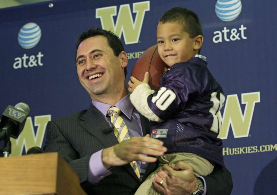 Steve Sarkisian's son Brady wore a Locker jersey during his introduction press conference in December 2008. Locker's production improved under Sarkisian, throwing for a career-high 21 touchdowns in 2009. (Dan DeLong/Seattle P-I) Photo: Dan DeLong