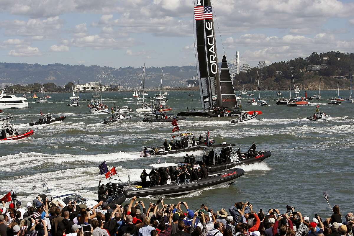 A sea of bats follows Oracle Team USA as they pass by Pier 27 after defeating Emirates Team New Zealand to win the America's Cup Finals in San Francisco, CA Wednesday September 25, 2013.
