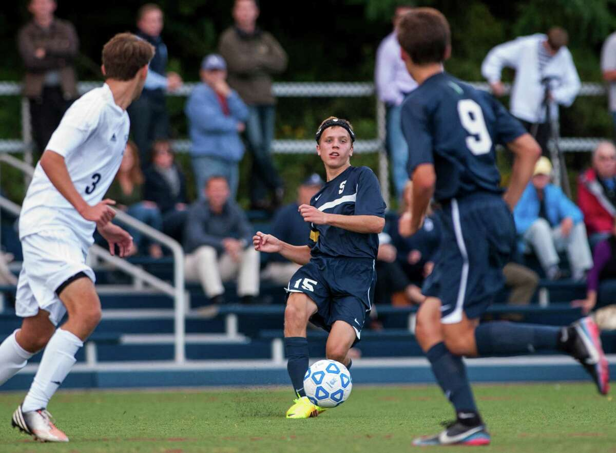 Staples high school's Jack Scott passes the ball to teammate Nate Argosh during a boys soccer game against Wilton high school played at Wilton high school, Wilton CT on Wednesday September, 25th, 2013.