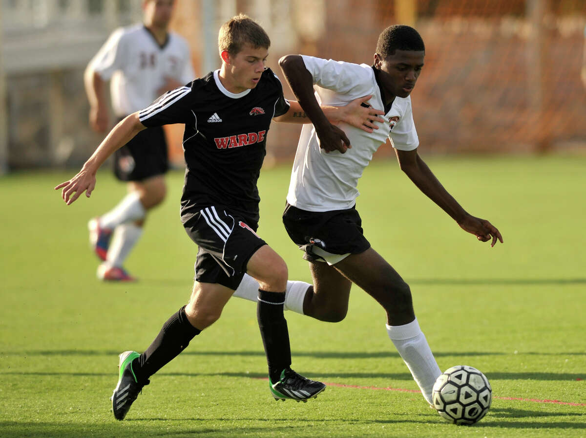 Fairfield Warde's Nathaniel Mattioli, left, and Stamford's Jonathan Boiteux battle for the ball during their game at Stamford High School in Stamford, Conn., on Wednesday, Sept. 25, 2013. Stamford beat Warde, 1-0.