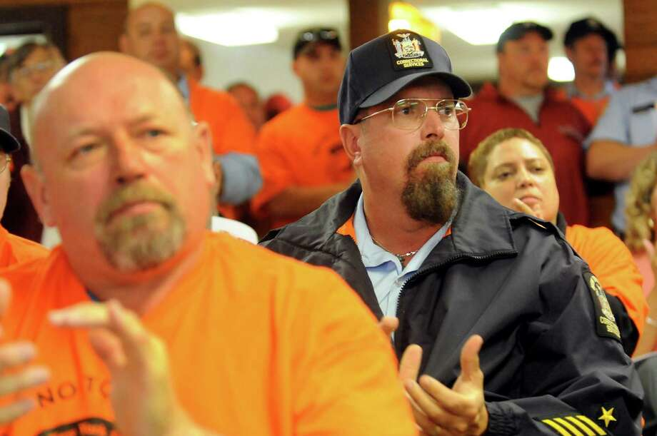 Correctional officers John Orton, left, and Gary Heusel, center, join members of their union, NYSCOPBA, as they applaud speakers during a rally against plans to close the state prison on Wednesday, Sept. 25, 2013, at Mt. McGregor Correctional Facility in Wilton, N.Y. (Cindy Schultz / Times Union) Photo: Cindy Schultz / 00023907A