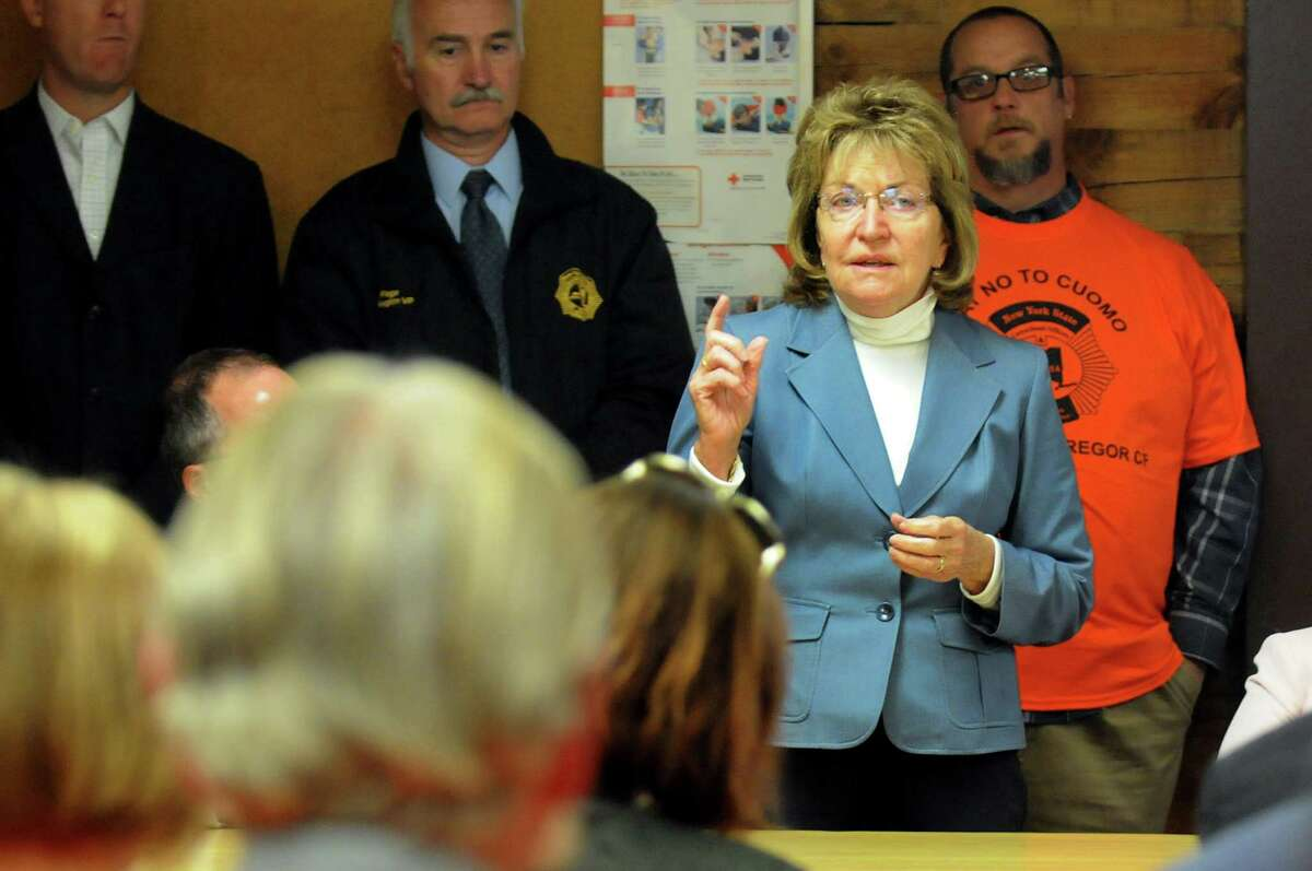 Sen. Betty Little, right, addresses members of a correctional officer's union, NYSCOPBA, during a rally against plans to close the state prison on Wednesday, Sept. 25, 2013, at Mt. McGregor Correctional Facility in Wilton, N.Y. (Cindy Schultz / Times Union)