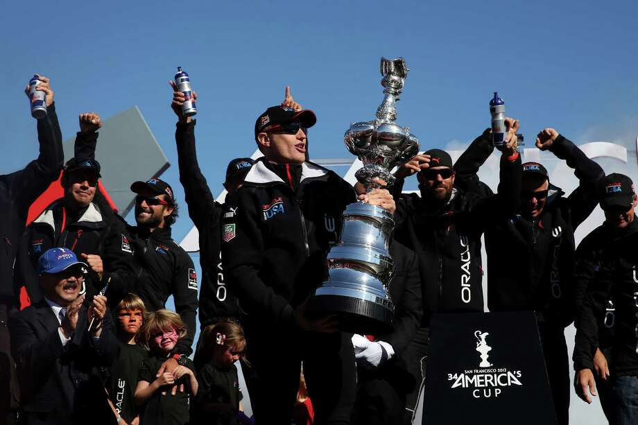 SAN FRANCISCO, CA - SEPTEMBER 25:  Skipper James Spithill of Oracle Team USA celebrates onstage after defending the Cup as they beat Emirates Team New Zealand to defend the America's Cup during the final race on September 25, 2013 in San Francisco, California.  (Photo by Justin Sullivan/Getty Images) ORG XMIT: 181973203 Photo: Justin Sullivan / 2013 Getty Images