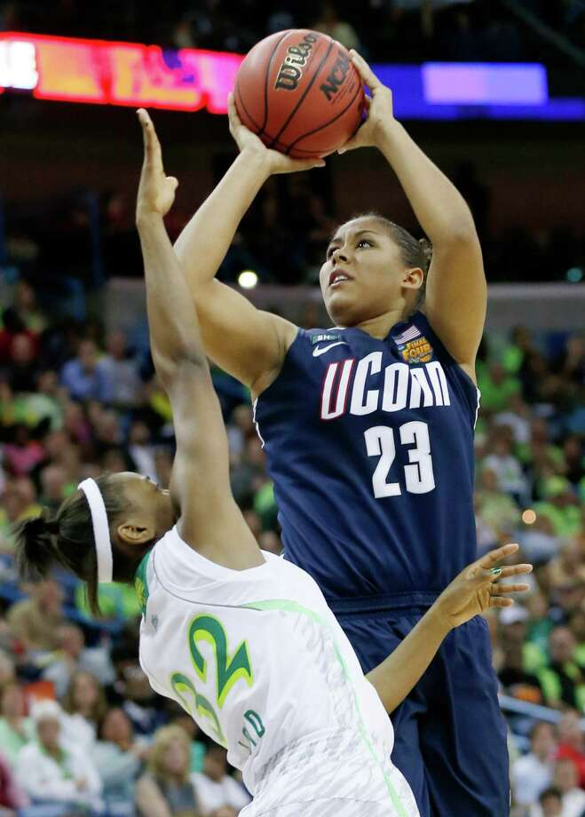 Connecticut forward Kaleena Mosqueda-Lewis (23) shoots against Notre Dame guard Jewell Loyd (32) in the second half of the women's NCAA Final Four college basketball tournament semifinal, Sunday, April 7, 2013, in New Orleans. (AP Photo/Dave Martin) Photo: Dave Martin, Associated Press / Associated Press