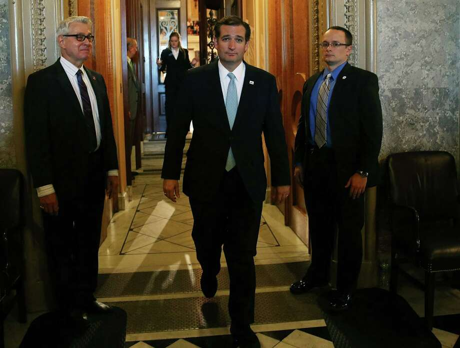 WASHINGTON, DC - SEPTEMBER 25:  Sen. Ted Cruz (R-TX) walks off the Senate floor after he spoke for more than 21 hours September 25, 2013 on Capitol Hill in Washington, DC. Sen. Cruz ended his marathon speech against the Obamacare at noon on Wednesday. (Photo by Mark Wilson/Getty Images) ORG XMIT: 182016712 Photo: Mark Wilson / 2013 Getty Images