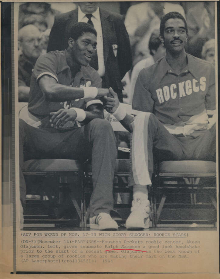 Winning only 14 games in 1982-83 allowed the Rockets to draft Ralph Sampson, right, and 29 wins the next season paved the way to picking Hakeem Olajuwon. / AP