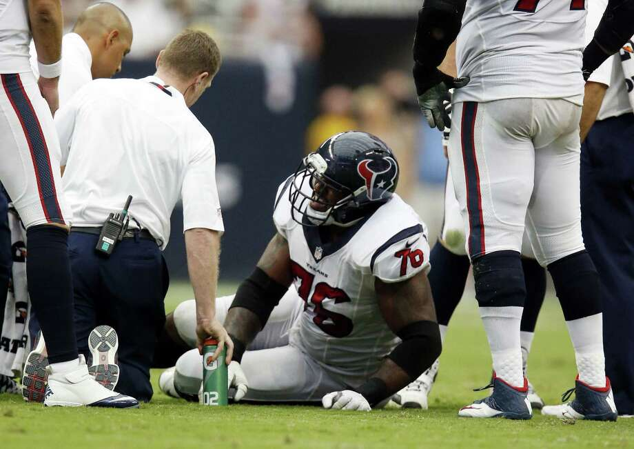 Texans left tackle Duane Brown, being tended to by trainers during Houston's Sept. 15 game against Tennessee, will be a game-time decision for Sunday against Seattle with a toe injury. Photo: Karen Warren / Houston Chronicle