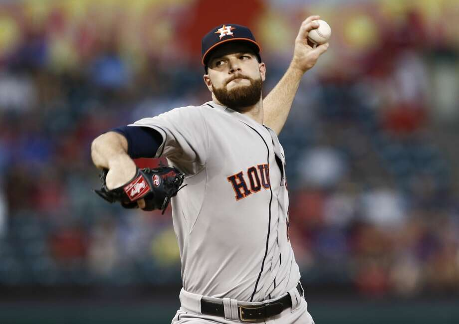 Astros starting pitcher Dallas Keuchel (60) delivers to the Rangers. Photo: Jim Cowsert, Associated Press