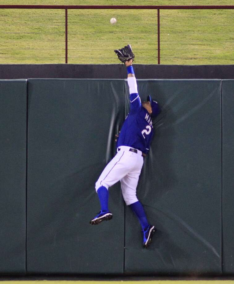 Rangers center fielder Leonys Martin leaps in vain for two-run home run by the Brandon Laird. Photo: Paul Moseley, McClatchy-Tribune News Service