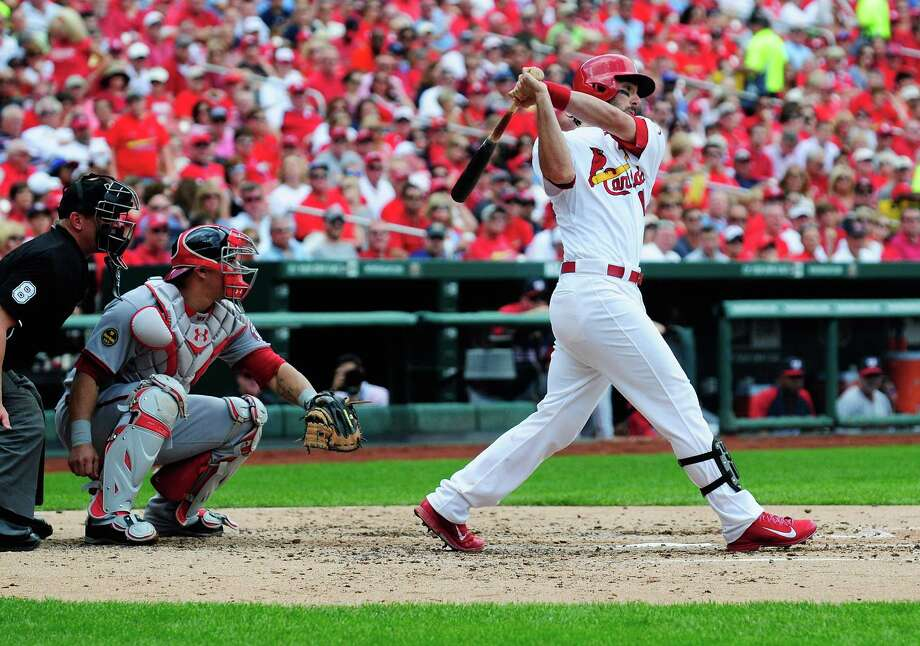 ST. LOUIS, MO - SEPTEMBER 25: Matt Carpenter #13 of the St. Louis Cardinals drives in a run as he grounds out to Adam LaRoche #25 of the Washington Nationals during the third inning at Busch Stadium on September 25, 2013 in St. Louis, Missouri.  (Photo by Jeff Curry/Getty Images) ORG XMIT: 163495763 Photo: Jeff Curry / 2013 Getty Images