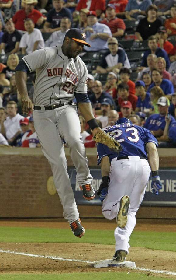 Another sloppy performance for the Astros begins with a third-inning error by shortstop Jonathan Villar, whose throw was too high for first baseman Chris Carter to retire Craig Gentry. Photo: Paul Moseley, MBR / Fort Worth Star-Telegram