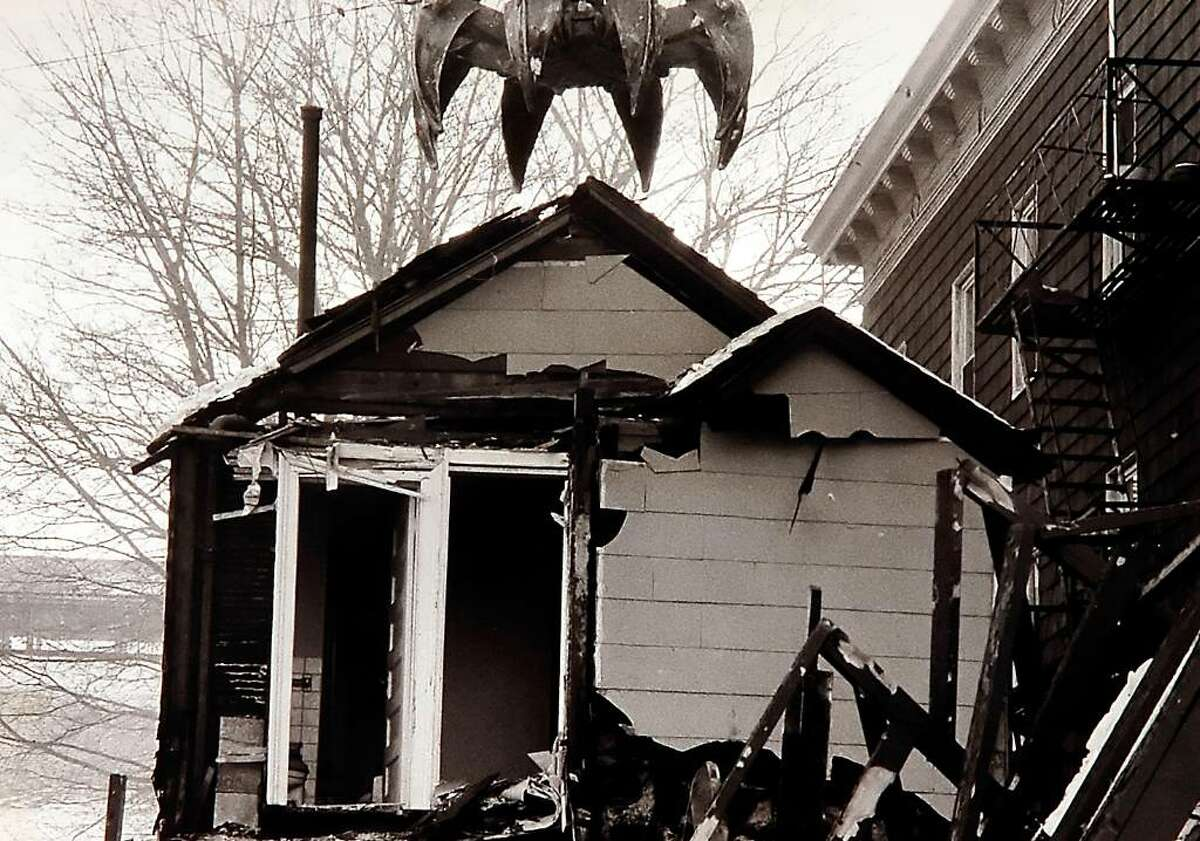 Jan. 24, 1985: The jaws of a demolition crane loom over the former Brownhall-Elder House on Division Street. The house, named after its previous owners, was built before the Civil War, according to Renee Kahn, director of the city's Historic Neighborhood Preservation Program. The leveled building was on land owned by Louis DeBeradinis.