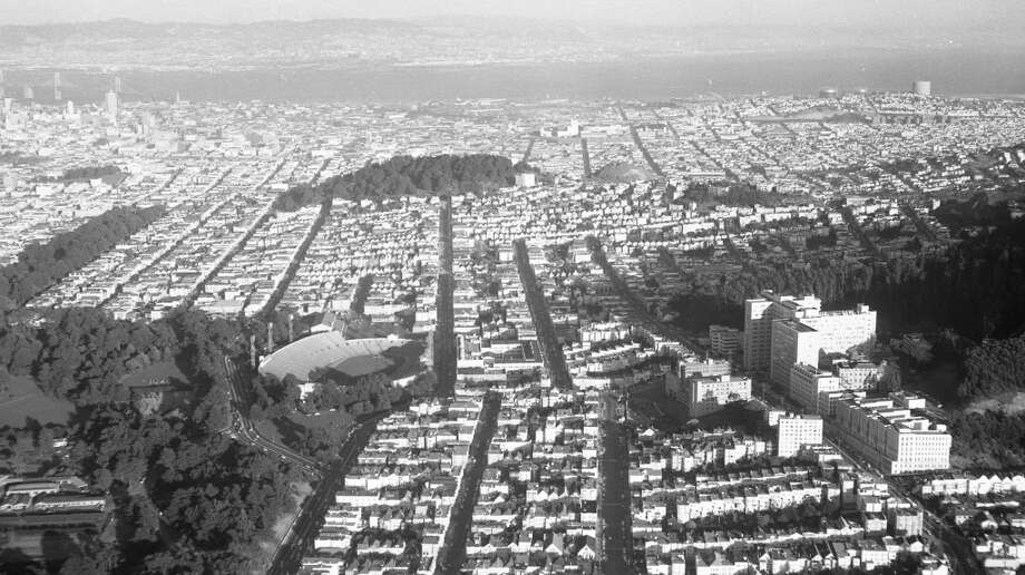 Kezar Stadium, just two days after the Y.A. Tittle-led 49ers suffered a 56-7 loss to the Rams. UCSF is to the right; the panhandle on the upper left. I wonder what this place was like without hippies. Photo: Duke Downey, The Chronicle