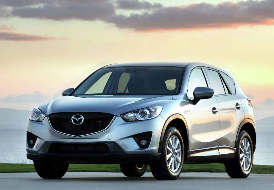 This undated image made available by Mazda shows the 2014 CX-5 compact sport utility vehicle. Photo: Mazda
