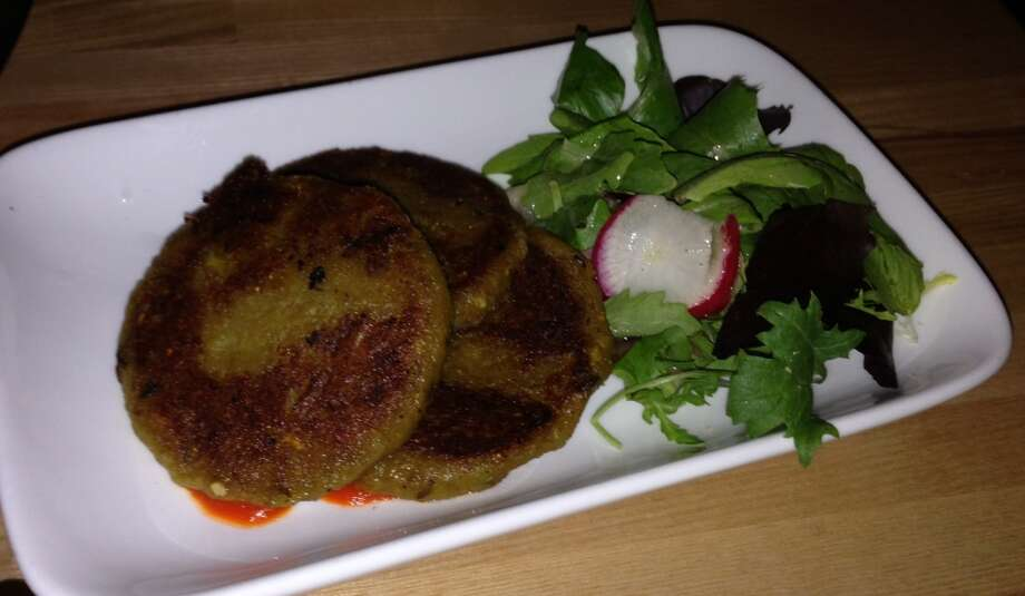 Steamed lotus patties with green chiles and cuman ($6.25)