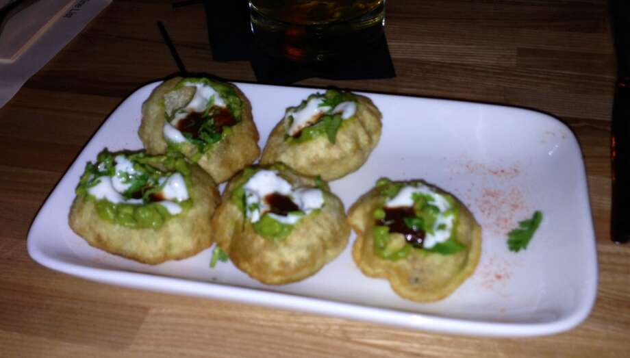 Avocado poori with lime and cilantro in wheat shells ($6)