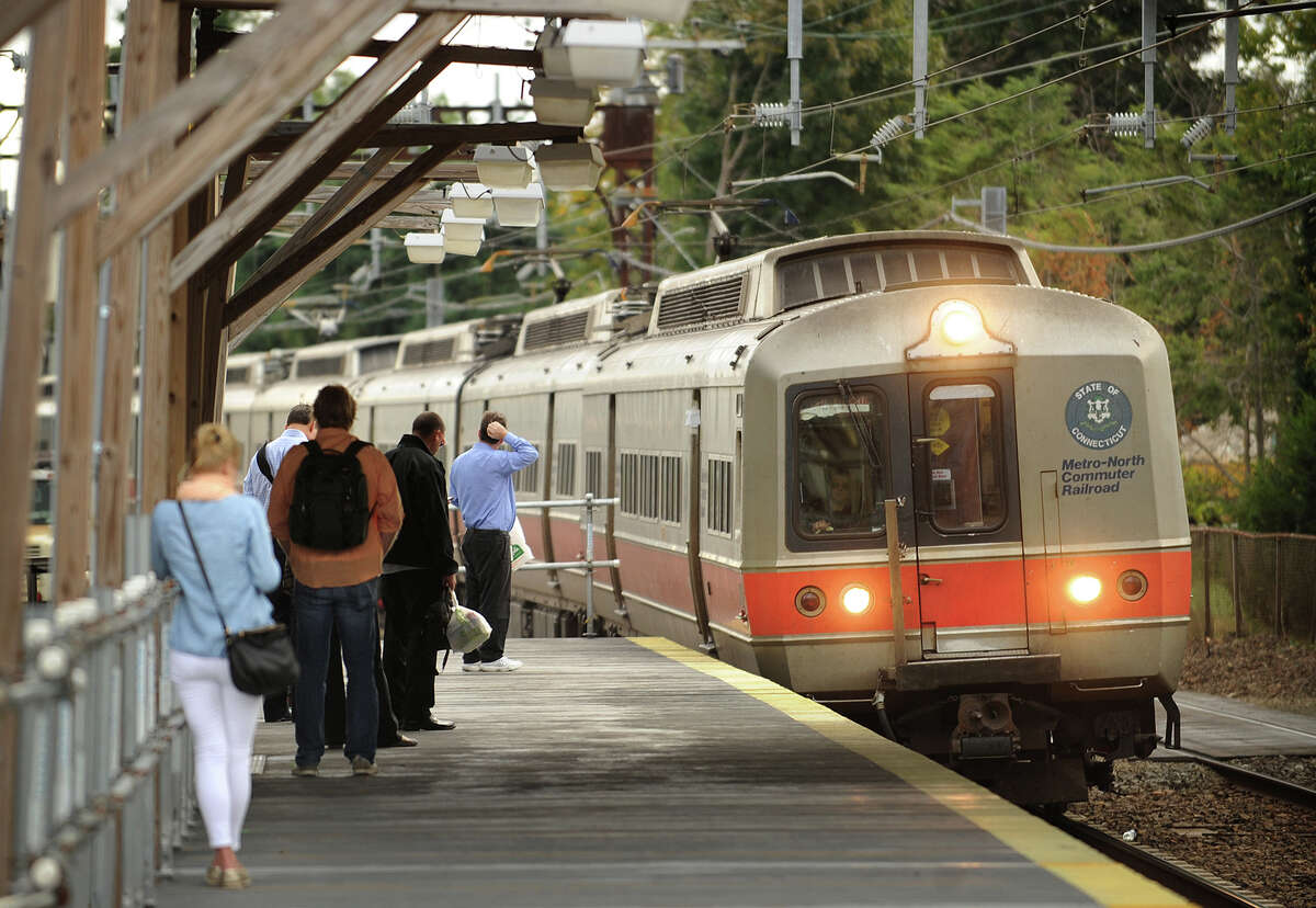 A southbound Metro North commuter train picks up morning riders at the Fairfield station on Thursday, September 26, 2013.