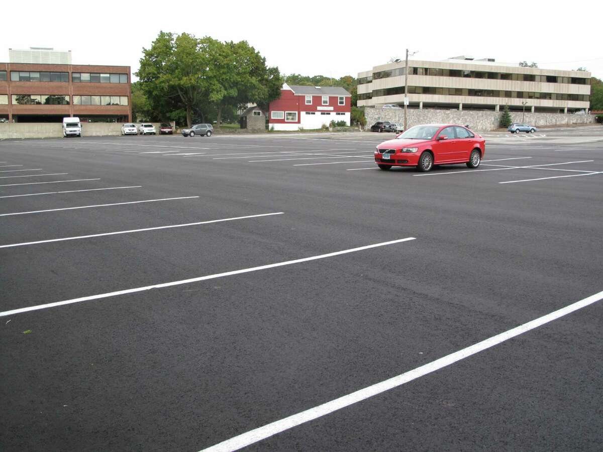 The lumber yard parking lot by the Elm Street train station, usually packed, was nearly deserted Thursday morning after mechanical failures disrupted train service on the Metro North line Wednesday. Sept. 26, 2013. New Canaan, Conn.
